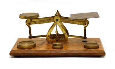 Lot 62 - An Edwardian gilt brass postal scale