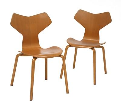 Lot 591 - A pair of teak 'Grand Prix' chairs