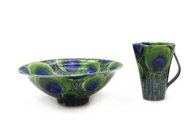 Lot 99 - A Dartington stoneware 'Peacock' jug and basin