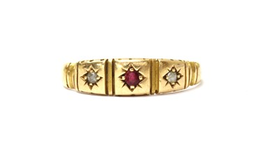 Lot 9 - A 15ct gold ruby and diamond three stone ring
