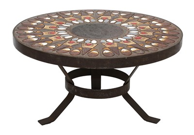 Lot 507 - A circular tile-topped coffee table