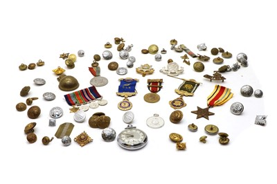 Lot 52 - A collection of military badges buttons and medals