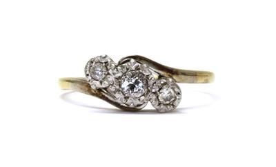 Lot 53 - A gold three stone diamond crossover ring