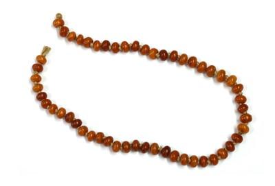 Lot 32 - A single row uniform butterscotch amber bead string