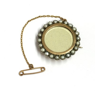 Lot 21 - A gold and silver, split pearl set brooch
