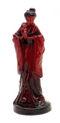 Lot 75 - A Royal Doulton Flambe figure titled 'The Geisha'