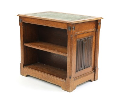 Lot 31 - An oak Gothic Revival double-sided open bookcase