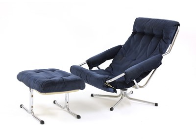 Lot 512 - A chrome lounger and stool