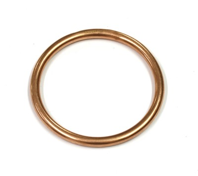 Lot 116 - A 9ct gold hollow round section bangle, by Henry Griffith & Son
