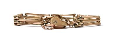 Lot 115 - A gold gate bracelet
