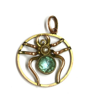 Lot 19 - An Edwardian gold paste and split pearl spider pendant