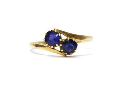Lot 4 - A gold two stone doublet crossover ring