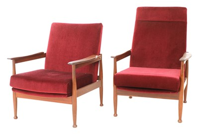 Lot 439 - Two afrormosia 'Manhattan' armchairs
