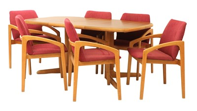 Lot 613 - A teak extending dining table