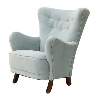 Lot 558 - A light blue upholstered armchair