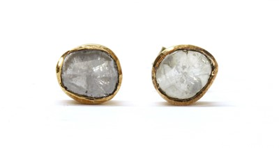 Lot 51 - A pair of gold foil-backed diamond stud earrings