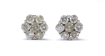 Lot 85 - A pair of white gold diamond daisy cluster earrings
