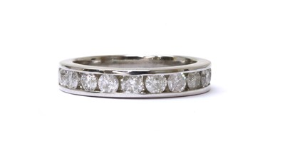 Lot 76 - A white gold diamond half eternity ring