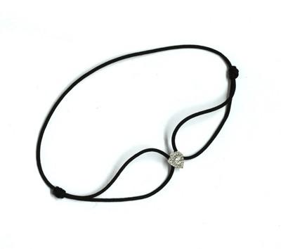Lot 83 - A white gold diamond cordette bracelet