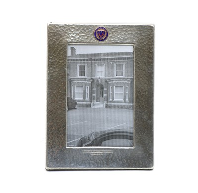 Lot 16 - An Art Deco hammered pewter easel backed photograph frame