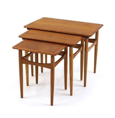 Lot 610 - A nest of teak tables
