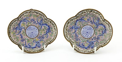 Lot 169 - A pair of Chinese export Canton painted enamel saucers