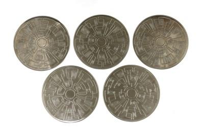 Lot 542 - A set of five Gabis steel trivets
