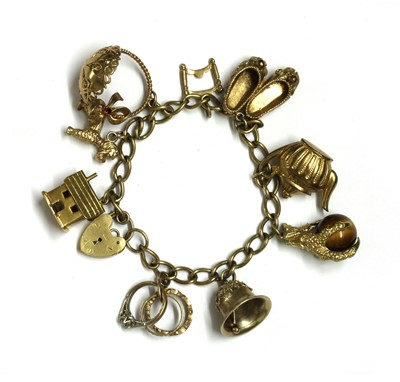 Lot 111 - A gold charm bracelet