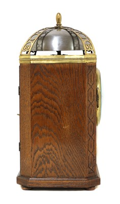 Lot 20 - An oak and brass-mounted mantel clock