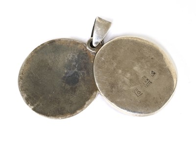 Lot 10 - A white metal locket