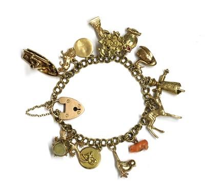 Lot 110 - A gold charm bracelet