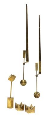 Lot 502 - Five brass candlesticks
