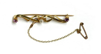 Lot 24 - A gold diamond and amethyst brooch