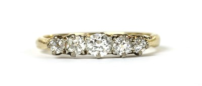 Lot 56 - A gold five stone diamond ring