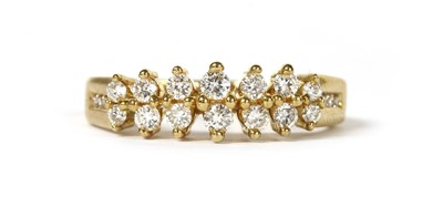 Lot 57 - An 18ct gold two row diamond ring