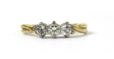 Lot 55 - An 18ct gold three stone diamond ring