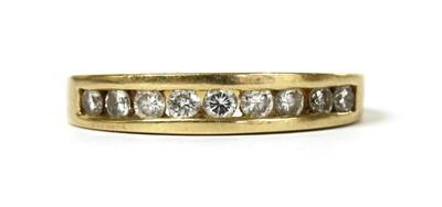 Lot 58 - An 18ct gold diamond half eternity ring