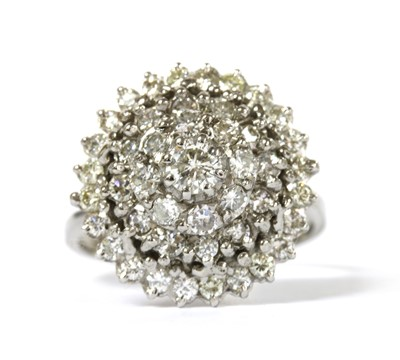 Lot 86 - A white gold diamond cluster ring