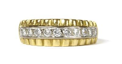 Lot 60 - A gold diamond half eternity ring