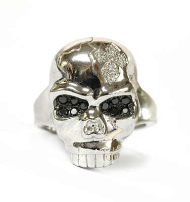 Lot 92 - A 9ct white gold diamond set skull ring