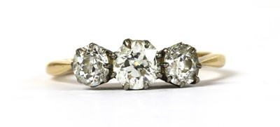 Lot 52 - A gold three stone diamond ring