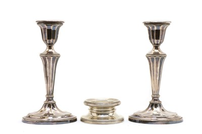 Lot 9 - A pair of silver candlesticks