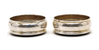 Lot 5 - A pair of silver coasters