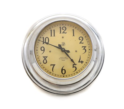 Lot 75 - A vintage design chrome cased wall clock