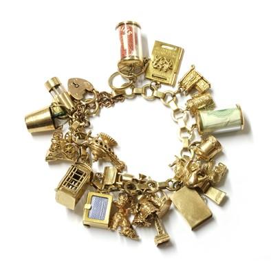 Lot 109 - A gold charm bracelet