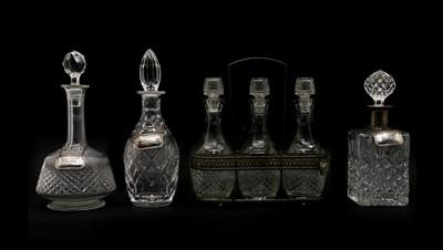 Lot 69 - A set of three cut-glass decanters