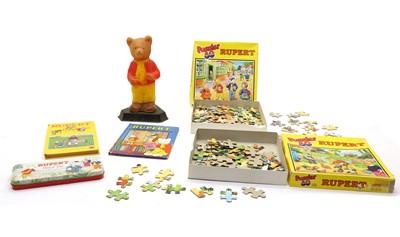 Lot 92 - An assortment of Rupert the bear annuals and jigsaws