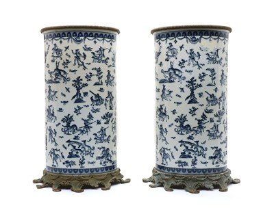 Lot 91 - A large pair of porcelain stick stands