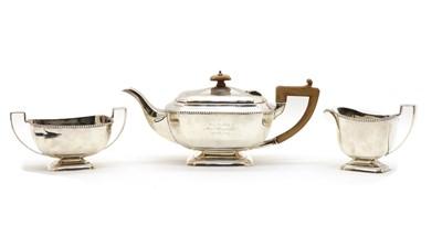 Lot 1 - A silver three piece tea service