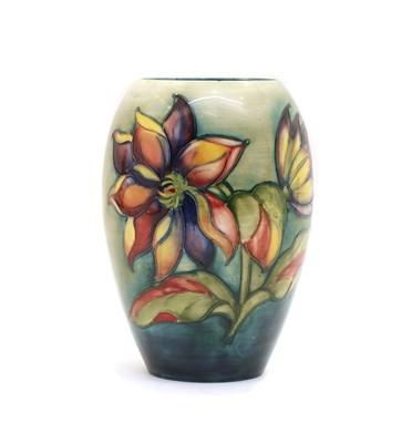 Lot 73 - A Moorcroft tubeline decorated 'Dahlia' pattern vase